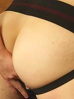 Josh Bensan pulls jock strap aside and strokes his dick.
